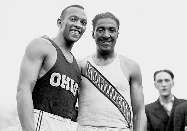 Winner of the 100-meter final in the Olympic trials at Randall's Island stadium in July 1936, Owens poses with Ralph Metcalfe, who finished second.