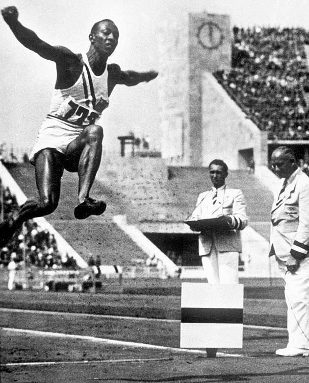 Jesse Owens competes and wins the gold in the long jump on Aug. 4, 1936.