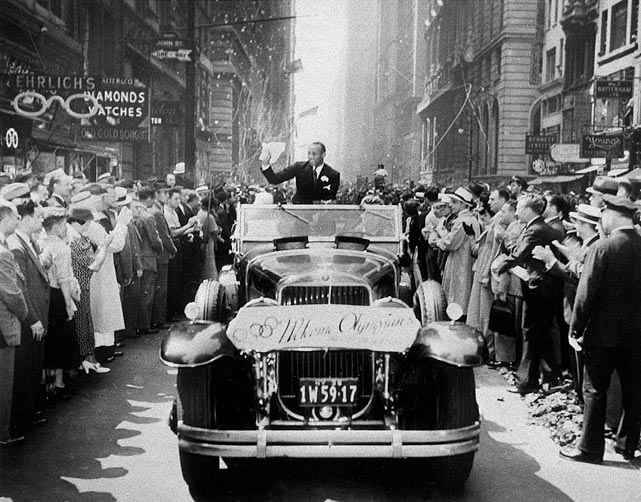 "Broadway was a ""snowstorm"" canyon as proud Manhattanites feted returned U.S. Olympic stars, like Jesse Owens, with a fleecy ticker tape parade on Sept. 3, 1936."