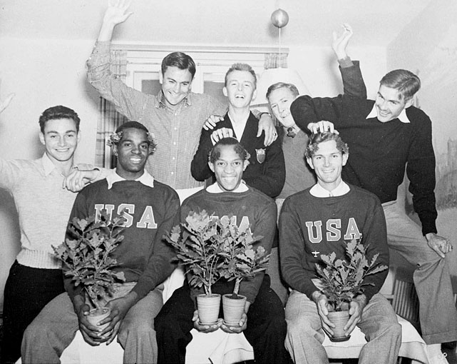 U.S. track and field stars (front row, left to right) Cornelius Johnson, Jesse Owens and Glenn Hardin are shown at their Olympic Village quarters as they receive congratulations from their U.S. Olympic teammates (back row, left to right) Marty Glickman, Gene Venzke, Albert J. Mangin, Foy Draper and Forrest G. Towns, for becoming the first three Americans to win gold medals in the 1936 Summer Olympics. Glickman was pulled from the 1936 Berlin Olympics because he was Jewish.