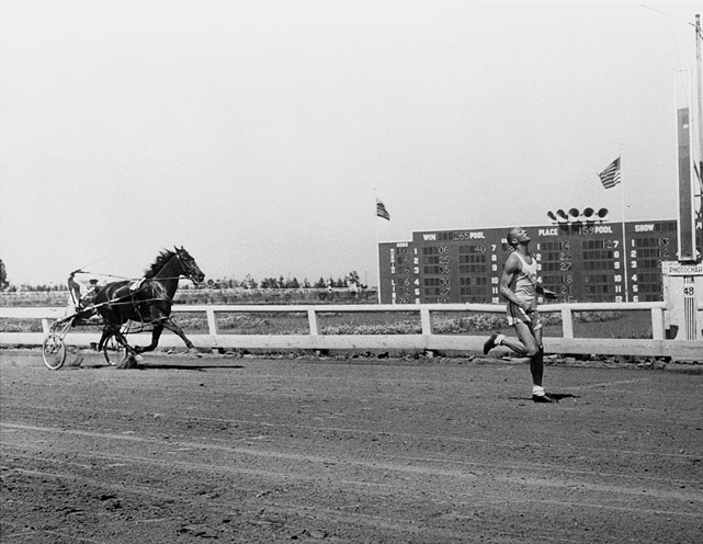 Owens crosses the finish line ahead of Ritchie Robert's pacer, The Ocean, at Bay Meadows track in San Mateo, Calif., June 19, 1948. The event was strictly for fun of the spectators at the harness meet.