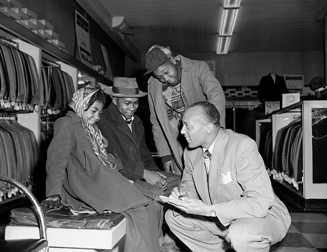 Owens autographs for admiring youngsters in a Chicago clothing store on Jan. 25, 1950, where he was a public relations and promotion man.