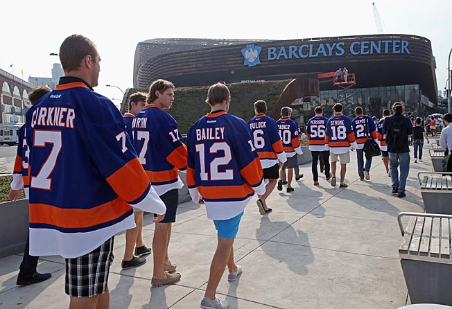 The Islanders head for their new barn after riding a Long Island Railroad train into Brooklyn.