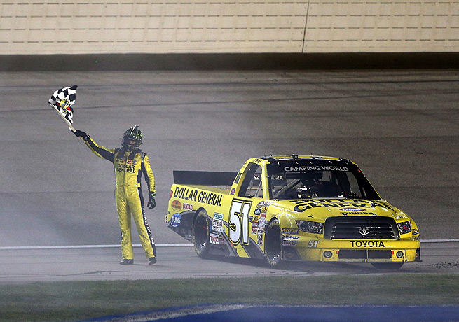 Kyle Busch celebrated with his truck following his win at Chicagoland Speedway.
