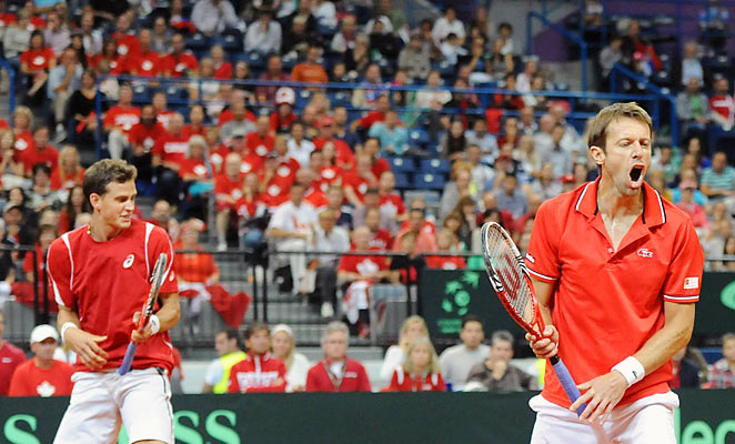 Vasek Pospisil (left) and Daniel Nestor put Canada in possession to reach its first Davis Cup final.