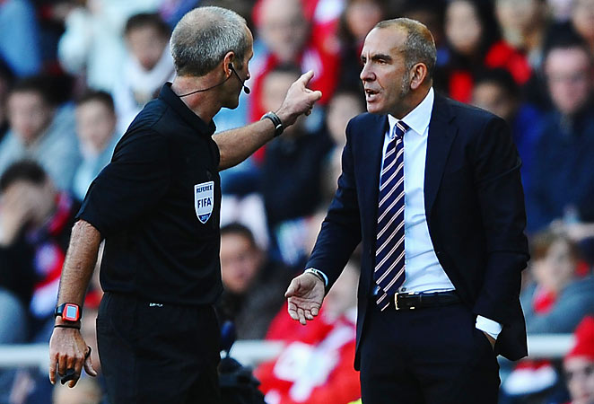 Paolo Di Canio was ejected from Sunderland's game against Arsenal for arguing with the referee.