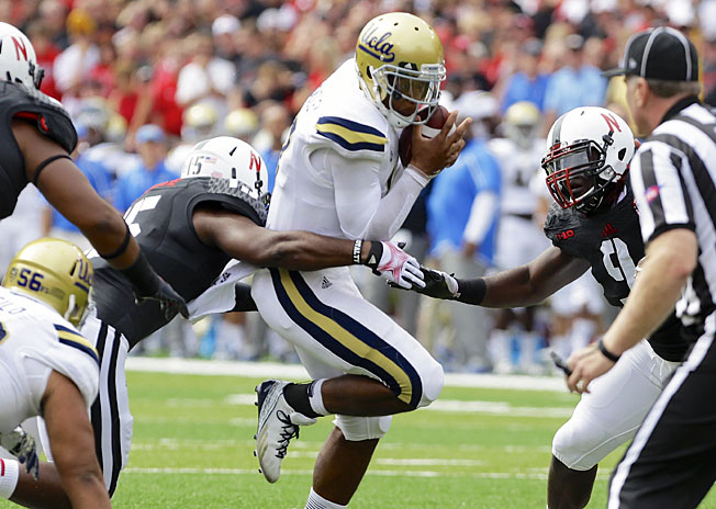 UCLA's Brett Hundley passed for 294 yards and three touchdowns in a comeback victory over Nebraska.