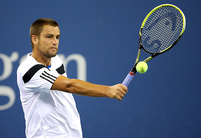 Mikhail Youzhny came back from one set down to defeat Alsan Karatsev 6-7 (5), 6-2, 6-2.