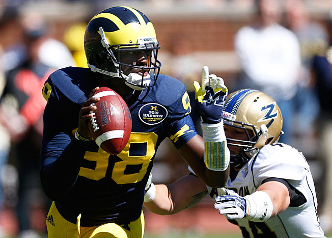 Devin Gardner (98) and Michigan fell in this week's rankings after barely scraping by Akron on Saturday.