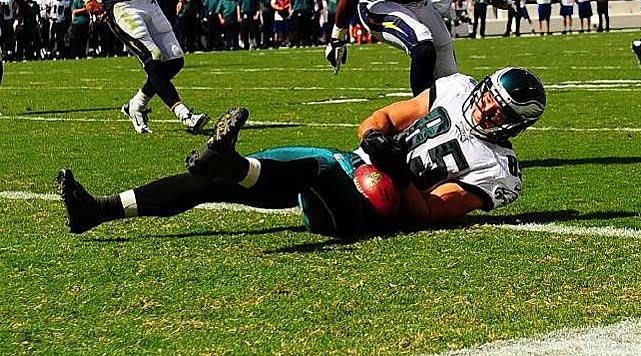 Replays showed that James Casey lost control of this ball while tumbling into the end zone, costing the Eagles a touchdown.