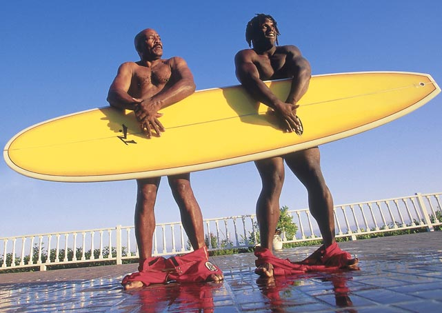 Newly drafted New Orleans Saint Ricky Williams poses with legendary running back Jim Brown. Thankfully, their surf boards allowed this photo to maintain a PG rating.