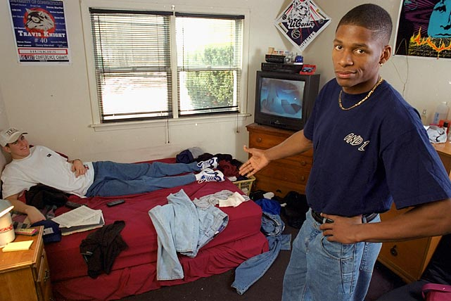 UConn shooting guard - and well known neat-freak - Ray Allen gestures with frustration at his roommate Travis Knight, whose messy ways drove Allen crazy. He would soon update his digs, however, earning nearly $200 million over a prolific NBA career that's still going strong.