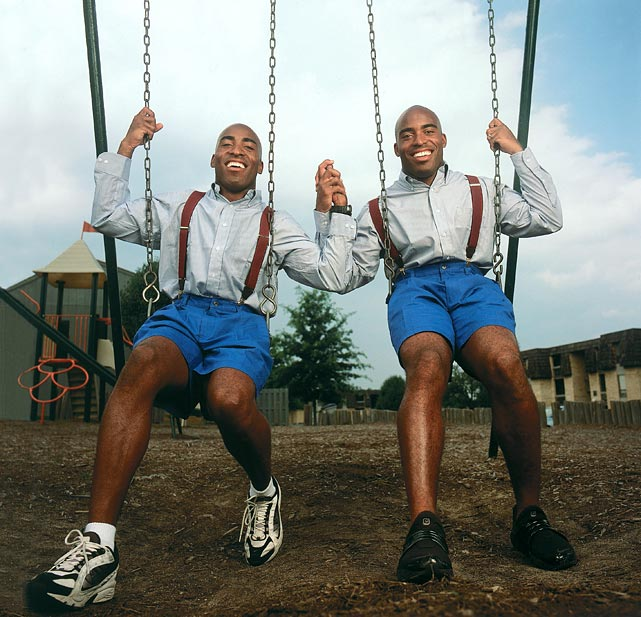 Twins Ronde and Tiki Barber hold hands on a swing set near their childhood home. Both men were stars at the University of Virginia before graduating to impressive NFL careers with the Buccaneers and Giants, respectively.
