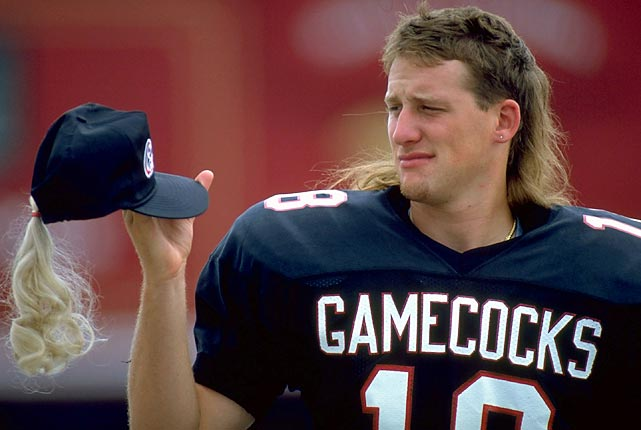 Despite being known for his goofball antics, South Carolina quarterback Steve Taneyhill won't crack a smile at this novelty mullet cap modeled after his long blonde locks.