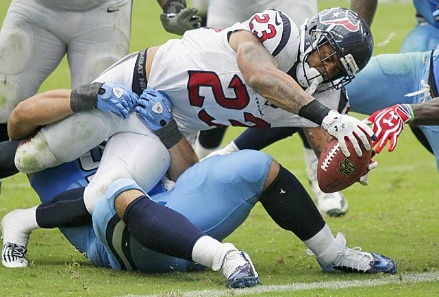 One play after he had scored on a touchdown run, Arian Foster barely stretched this two-point conversion try across the goalline to tie the game. Houston went on to win in overtime.