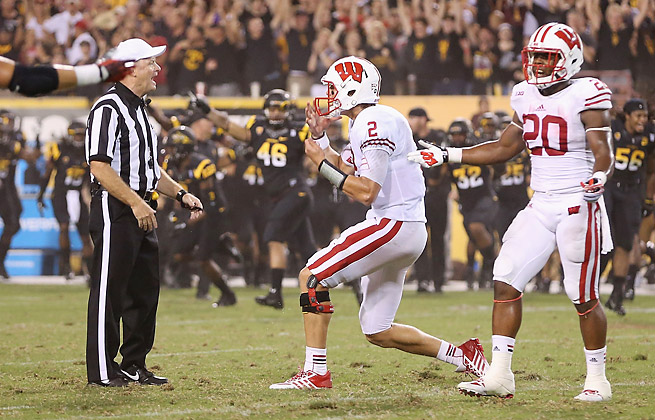 Quarterback Joel Stave (2) and Wisconsin lost to Arizona State after a baffling end-of-game controversy.