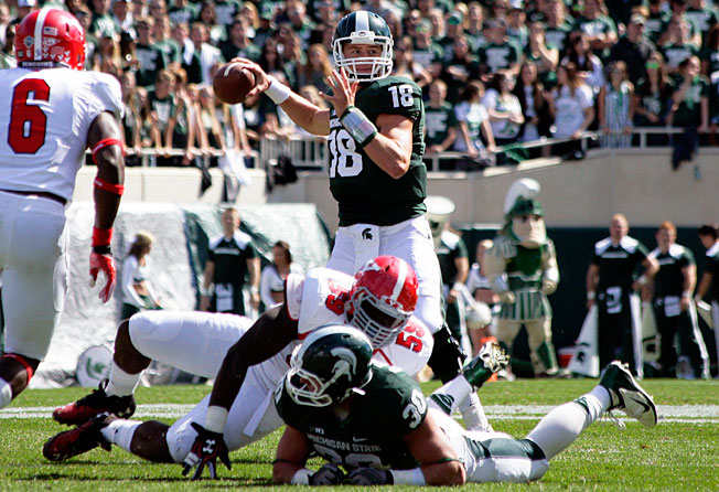 Michigan State's Connor Cook (18) threw for 202 yards and four scores in a win over Youngstown State.