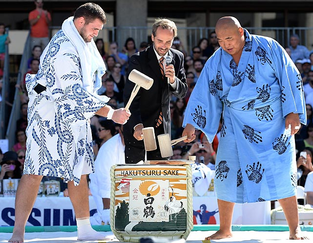 Gettin' hammered: (<italics>Left to right</italics>) Soslan Gagloev, event director Andrew Freund, and Byambajav Ulambayar bust open a barrel of sake before the start of the annual wrasslin' event at the Japanese American Cultural & Community Center Plaza in Los Angeles.