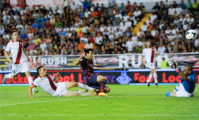 Pedro scored three goals as Barcelona rolled to a 4-0 win over Ray Vallecano.