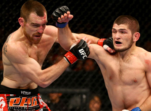 Khabib Nurmagomedov (right) improved his record to 21-0 by beating Pat Healy at UFC 165.