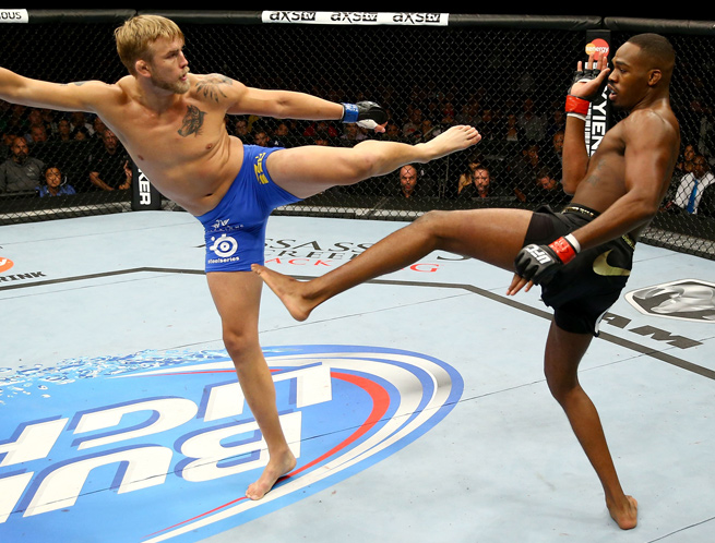 Jon Jones (right) and Alex Gustafsson went five rounds in their title fight at UFC 165.