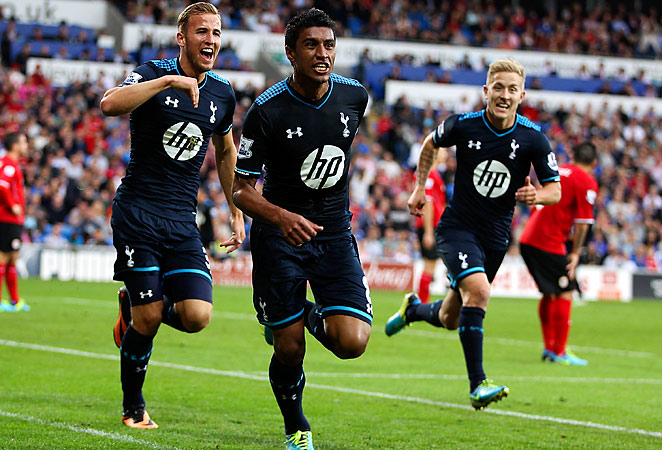 Paulinho hit a clever finish in injury time as Tottenham pulled out an important win over Cardiff.