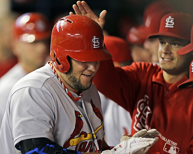The Cardinals' Matt Adams celebrates after hitting a two-run home run on Saturday night.