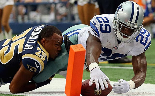 A diving DeMarco Murray was awarded a touchdown on this play because the ball touched the pylon, to the chagrin of a helmetless T.J. McDonald.
