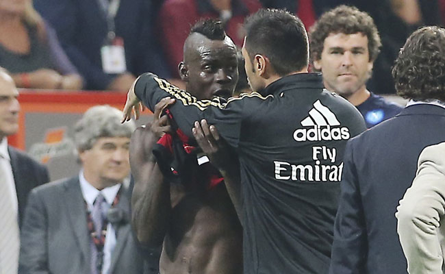 After receiving a second yellow card, Mario Balotelli was restrained by teammate Marco Amelia.