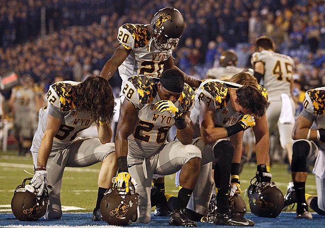 Wyoming's Nehemie Kankolongo (28) took a knee before going up against Air Force on Saturday.