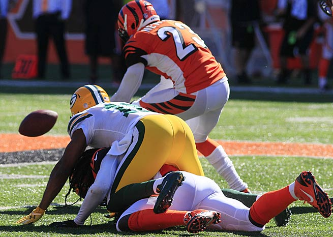 Terence Newman scooped up this fumble and returned it for the winning touchdown in Cincinnati's victory over Green Bay.