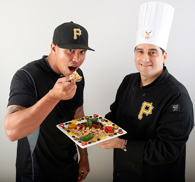 Jose Tabata takes a bite of some healthy food prepared by team chef Anthony Palatucci.