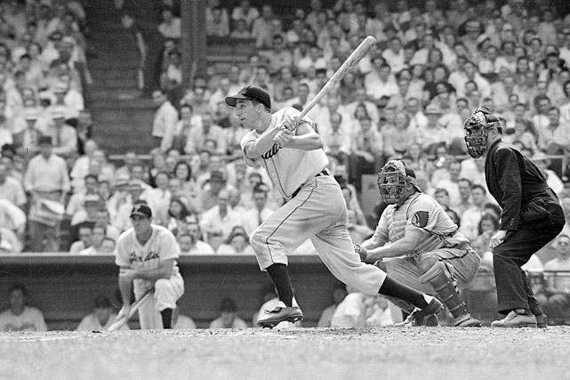 Ralph Kiner hits a single during a game against the Boston Red Sox in Pittsburgh. Though injuries forced his retirement from active play after 10 seasons, Kiner's tremendous slugging outpaced nearly all of his National League contemporaries between the years 1946 and 1954.