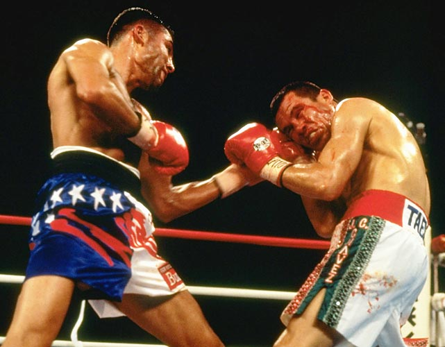 "In the course of his fabled career, Chávez had become his country's most celebrated and beloved boxer, the very model of the classic Mexican ring warrior. Now, at 33, he would take on a new-look Mexican-American champion, Oscar De La Hoya, a decade his junior. Years before, Chávez had schooled the teenage De La Hoya in a legendary East L.A. sparring session, but on this night at Caesars Palace in Las Vegas, the ascendent Golden Boy tore into the old master, cutting Chávez badly and stopping him in the fourth round. It was a sad moment for Chávez's fans, but, as Richard Hoffer wrote in SI at the time, ""There remains a deep reservoir of goodwill for Chávez among his countrymen, and his legacy will not suffer. ... He was too great for too long."""