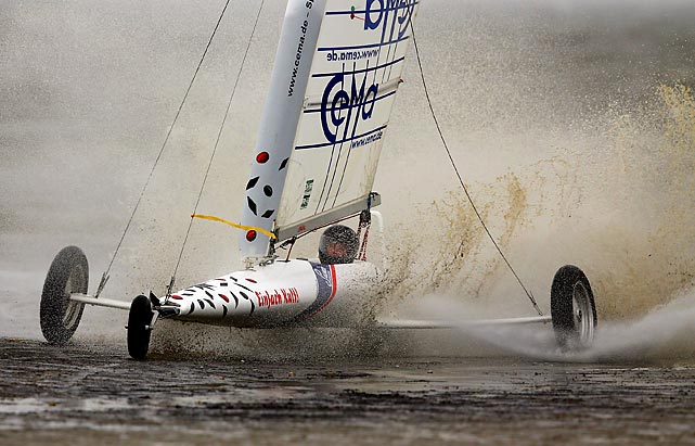 A competitor races in the beach sailing championship in St Peter-Ording, Germany.