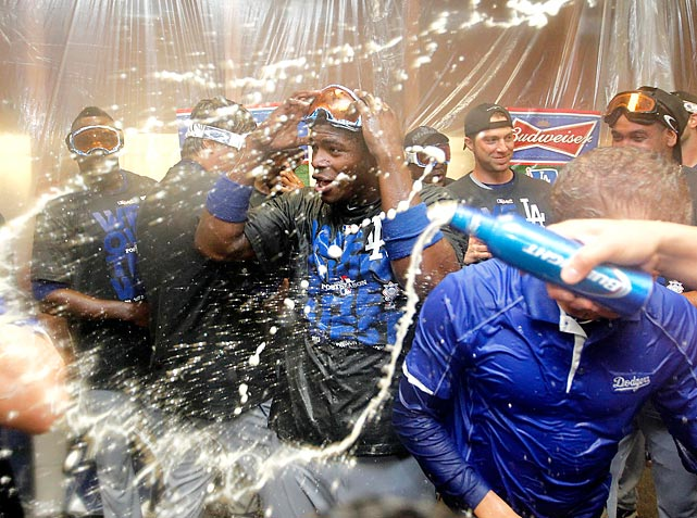 The Los Angeles Dodgers celebrate their playoff-clinching 7-6 win over the Arizona Diamondbacks. The Dodgers stirred up some controversy when they celebrated in the Diamondbacks' pool, located just beyond the rightfield wall.