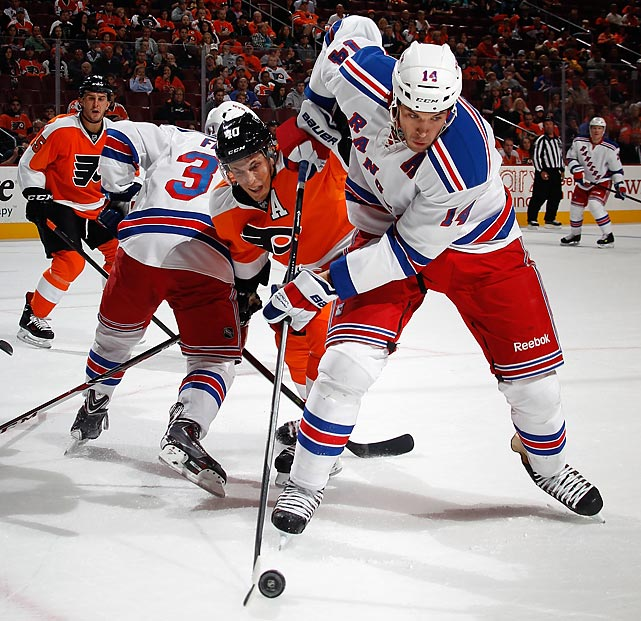 New York Rangers forward Tyler Pratt (14) navigates the wall while shielding the puck from Philadelphia Flyers forward Vincent Lacavalier