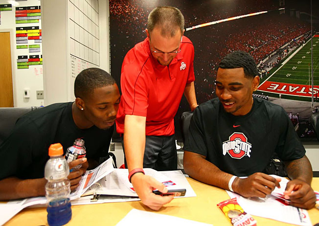 Ohio State coordinator Tom Herman works extensively with QBs Kenny Guiton (left) and Braxton Miller.