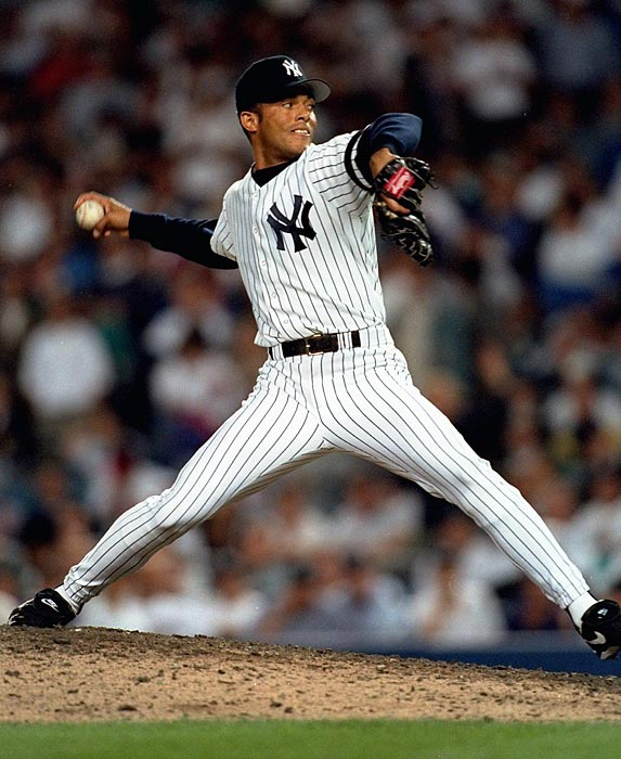 As a rookie, the 25-year-old Rivera spent the first three-quarters of his season bouncing between the rotation ? where he was knocked around for a 5.94 ERA in 10 starts ? and Triple-A Columbus. Not until September did he move to the bullpen for good, but when he did, he began to win New York manager Buck Showalter's trust. Rivera's introduction to the postseason ? which he would eventually come to dominate as no other pitcher had before ? came in the top of the 12th inning of Game 2 of the Division Series against the Mariners. He took over for a spent John Wetteland, who had pitched 3 1/3 innings of scoreless ball until serving up a tiebreaking solo homer to Ken Griffey Jr., and then a single to Edgar Martinez. Rivera struck out Jay Buhner to end the frame, then stayed on after the Yankees tied the score at 5-5 in the bottom of the 12th. He retired the first eight hitters he faced before Martinez and Buhner singled with one out in the 15th. Rivera responded by whiffing Doug Strange and getting future teammate Tino Martinez on a flyball. Jim Leyritz won the game with a solo homer in the bottom of the 15th, giving the Yankees a 2-0 series lead ? one that alas, they would not hold.