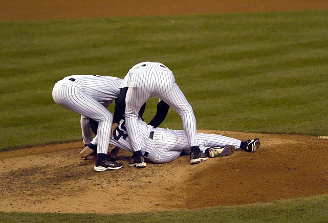 In an American League Championship Series Game 7 for the ages, the Yankees survived Clemens' infamous early implosion, clawing their way back from a three-run deficit to tie the score at 5-5 in the eighth after Grady Little left Pedro Martinez in for too long. The indomitable Rivera came on in the top of the ninth and retired nine of the 11 hitters he faced, throwing 48 pitches, stranding men on second base in both the ninth and the 10th innings and ending a 1-2-3 11th with a strikeout of Doug Mirabelli. When Aaron Boone hammered Tim Wakefield's first pitch for a solo homer in the bottom of the 11th, the Yankees were American League champions. The sight of a spent Rivera kneeling on the mound in thanks and exhaustion ?before Boone had even finished rounding the bases ? remains one of the most indelible images of his career. He was named ALCS MVP.