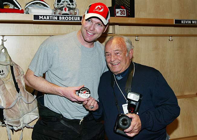 New Jersey Devils goalie Martin Brodeur with his father, Denis, in March 2009. Denis has died at 82.