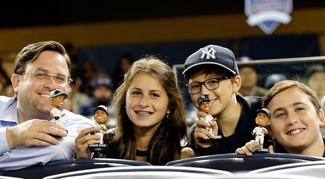 This family unit is clearly pleased, but the Great Mariano Rivera Bobblehead Kerfuffle threatened to get ugly when fans were forced to wait on long lines for a long time because a truckload of the tsotchkes failed to arrive at Yankee Stadium until well into the game.
