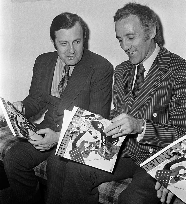 Maple Leafs goalie Jacques Plante looks at a book, <italics>Devant le Filet, </italics>with his photo on the cover in 1973.
