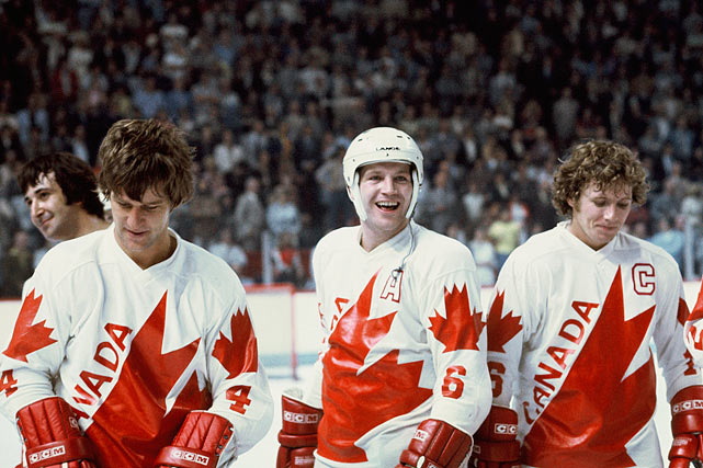 Bobby Orr, Denis Potvin and Bobby Clarke of Team Canada celebrate a win against Czechoslovakia after the Canada Cup Final held at the Montreal Forum on Sept. 15, 1976.
