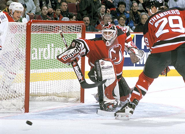 Devils goalie Martin Brodeur lunges toward a puck heading for the net in a game against the Canadiens at the Molson Centre in Montreal during the 1996-97 season.