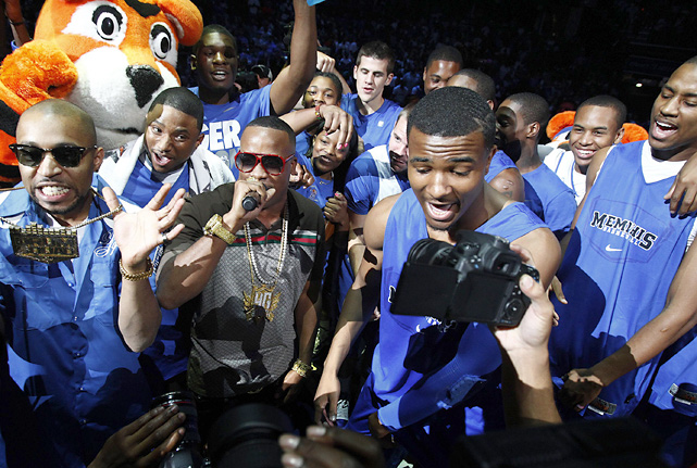 Members of the Memphis men's and women's basketball teams sing along with Yo Gotti during Memphis Madness at the The FedExForum in 2011.
