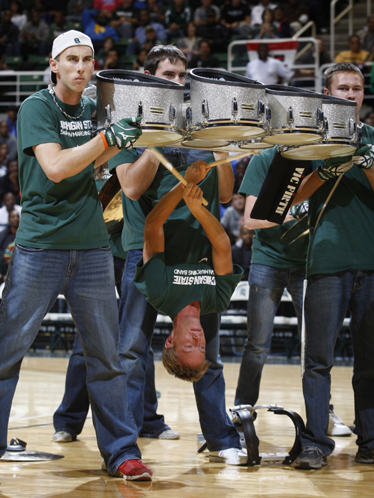 The Michigan State marching band's drumline gives an inverted performance before the team's Midnight Madness scrimmage in 2011.