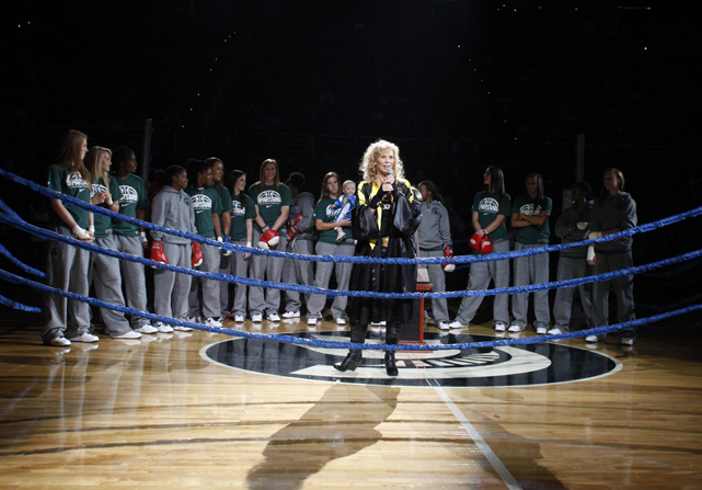 Surrounded by players, Michigan State women's basketball coach Suzy Merchant speaks to the crowd before the team's Midnight Madness scrimmage.