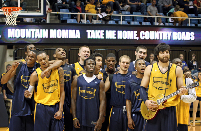 "West Virginia's Deniz Kilicli leads his Mountaineer teammates in singing ""Country Roads"" during Mountaineer Madness at WVU Coliseum."