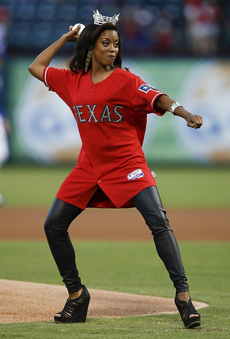 Gracing the mound at Arlington Stadium, Miss Texas displays the form that has made her home state a cradle of legendary hurlers.